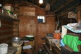 Хозяйственное помещение дома или чулан с сундуками.