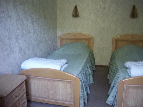 Дом отдыха: спальня в люксе