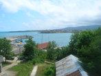Вид на порт и квартал Василико с балкона гостевого дома Sun house