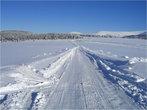 Дорога, ведущая к центру, вдалеке дорога М52