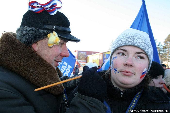 Российско-дёминская символика на лицах болельщиков.