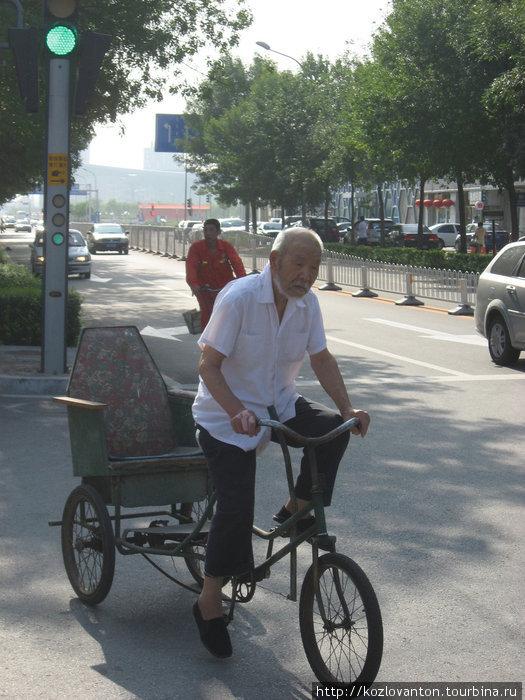 Китайский рикша: в поисках пассажира.