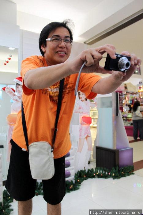 Китаец Джим фотографирует на память