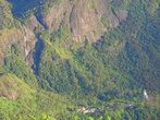 Внизу горы, водопады, храмы, деревня