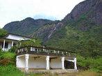 Постройки монастыря под горой с водопадом