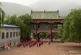Спортивная школа-интернат, где китайских детей учат кунфу. Некоторые из них, кажется, только научились ходить...