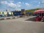 Когда-то тут был рынок, продавали как вещи, овощи так и мелкую живность, теперь же тут сплошные торговые центры.