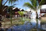 Коттеджи на берегу — прилив