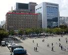 Железнодорожный вокзал города Пусана стоит на красивой площади с фонтаном, окруженной современными высотками, среди которых есть парочка отелей.